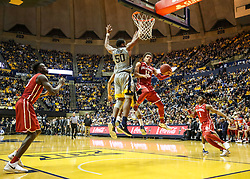 Jan 6, 2018; Morgantown, WV, USA; West Virginia Mountaineers forward D'Angelo Hunter (11) makes a move in the lane during the second half against the West Virginia Mountaineers at WVU Coliseum. Mandatory Credit: Ben Queen-USA TODAY Sports
