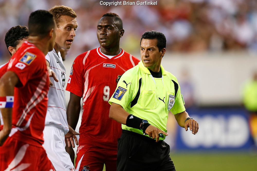 July 18 2009: Jimmy Conrad of the USA speaks to Referee Armando Archundia during the game between USA and Panama. The United States defeated Panama 2-1 in added extra time in a CONCACAF Gold Cup quarter-final match at Lincoln Financial Field in Philadelphia, Pennsylvania.