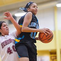 Navajo Prep Eagle Martinique Larding (11) grabs a rebound from Rehoboth LynxKennedi Chapman (40) Friday at Rehoboth High School.