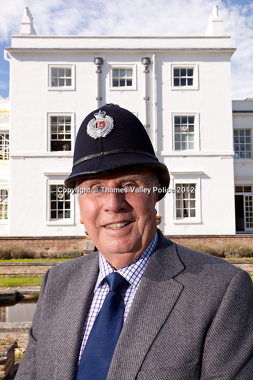A Portrait of Ken Wells, Curator of Thames Valley Police Museum, who retires this year (2012) after a half century of service with the police. He is pictured with an original Berkshire Constabulary helmet and the photographs are taken through (and alongside) his own original MPP Large Format Plate Camera that he used whilst a SOCO.<br />  Ken started with the Metropolitan Police, before transferring to Berkshire Constabulary. He was originally a beat copper before becoming a Scenes of Crime Officer, as both a constable and then as a member of police staff. On reitrement, Ken became curator of the museum based at Sulhamstead. Sulhamstead, UNITED KINGDOM. September 13 2012. <br /> Photo Credit: MDOC/Thames Valley Police<br /> © Thames Valley Police 2012. All Rights Reserved. See instructions.