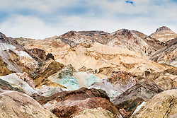 The Artist's Palett, Death Valley, California. The colors of this odd place spans a soft, pastel spectrum ranging from pinks to blues to green. It was formed when volcanic rocks deep underground interacted with hydrothermal systems to form concentrated mineral deposits.