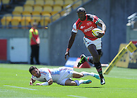 Kenya's Collins Injera against France at the IRB International Rugby Sevens, Westpac, Wellington, New Zealand, Friday, February 01, 2013. Credit:SNPA / Ross Setford