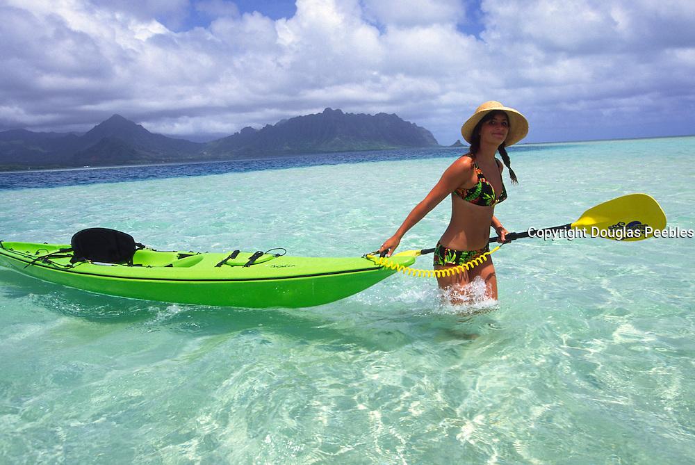Woman with kayak, Kaneohe Bay, Oahu, Hawaii<br />