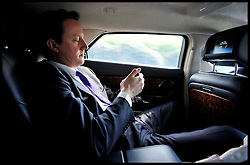 The Prime Minister David Cameron traveling back in his car to his West Oxfordshire office during the Libya crisis, Friday April 15, 2011. Photo By Andrew Parsons / i-Images.