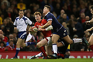 Rhys Patchell of Wales is tackled by Huw Jones of Scotland (r). Wales v Scotland, NatWest 6 nations 2018 championship match at the Principality Stadium in Cardiff , South Wales on Saturday 3rd February 2018.<br /> pic by Andrew Orchard, Andrew Orchard sports photography