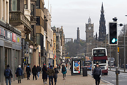 Edinburgh, Scotland, UK. 28 December 2020. Scenes from Edinburgh City Centre as Scotland starts first weekday under the most severe level 4 lockdown with all non-essential businesses closed. Pic ; Princes Street quieter than normal as virtually all shops are closed  Iain Masterton/Alamy Live News