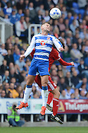 Reading midfielder Oliver Norwood wins a header during the Sky Bet Championship match between Reading and Middlesbrough at the Madejski Stadium, Reading, England on 3 October 2015. Photo by Alan Franklin.