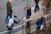 A Facist supporter abusing a local resident as Anti Facist demonstrators march through Dover protesting against a facist demonstration also taking place in the port town. 30th January 2016