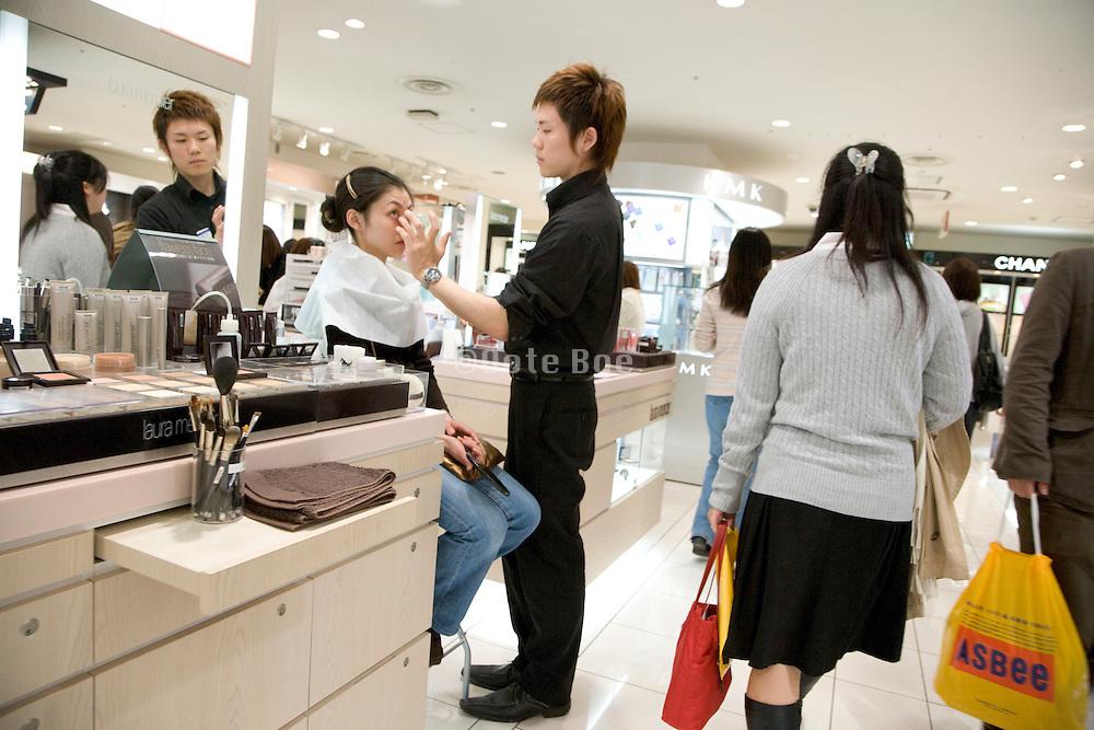 a woman being made up by a makeup artist sales clerk Japan Tokyo