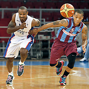 Anadolu Efes's Dontaye Draper (L) and Trabzonspor's Jerome Randle (R) during their Turkish Basketball League match Anadolu Efes between Trabzonspor at Abdi Ipekci Arena in Istanbul Turkey on Sunday 19 October 2014. Photo by Aykut AKICI/TURKPIX