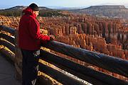 USA, Utah, Bryce Canyon National Park, hiker enjoying sunrise at Inspiration Point, MR