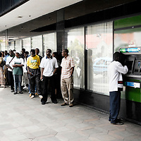 Harare, Zimbabwe 17 November 2007<br /> Hyperinflation, current at 8.000 %, generates eternal queues at the automatic tellers machines (ATM) of the banks. People withdraw the maximum daily amount, since they know that, the following day, the same amount of money will not even worth the paper on which it was printed.<br /> Photo: Ezequiel Scagnetti