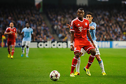 Bayern Midfielder David Alaba (AUT) is challenged by Man City Midfielder Jesus Navas (ESP) during the first half of the match - Photo mandatory by-line: Rogan Thomson/JMP - Tel: Mobile: 07966 386802 - 02/10/2013 - SPORT - FOOTBALL - Etihad Stadium, Manchester - Manchester City v Bayern Munich - UEFA Champions League Group D.