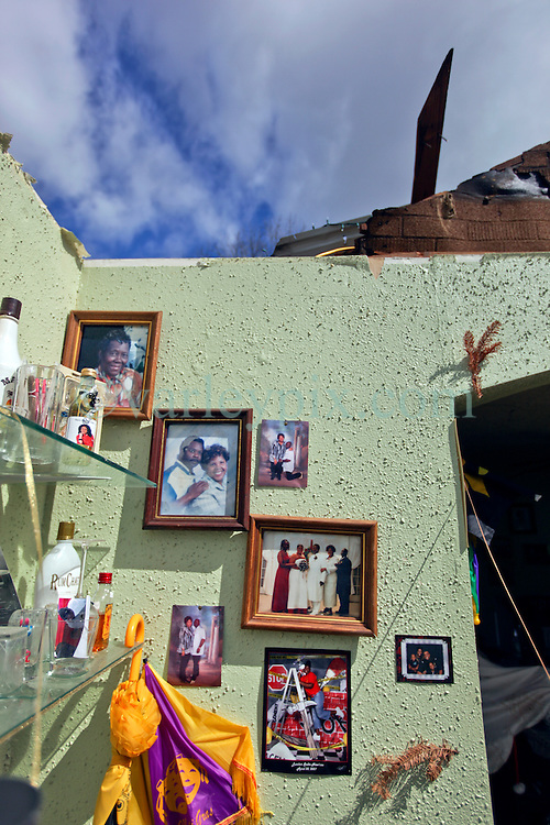 24 February 2016. Water tower Street, Convent, Louisiana.<br /> Devastation following a deadly EF2 tornado touchdown. 2 confirmed dead. <br /> Michael Davis (54 yrs) credits his faith for saving him from the deadly tornado which destroyed his house. Family images hang untouched on the walls.<br /> Photo©; Charlie Varley/varleypix.com