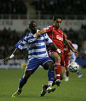 Photo: Lee Earle.<br /> Reading v Liverpool. Carling Cup. 25/09/2007. Reading's Leroy Lita (L) battles with Alvaro Arbeloa.