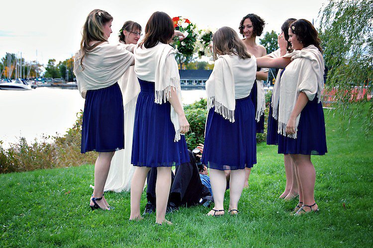 On my back surrounded by bridesmaids, lining up my shot.