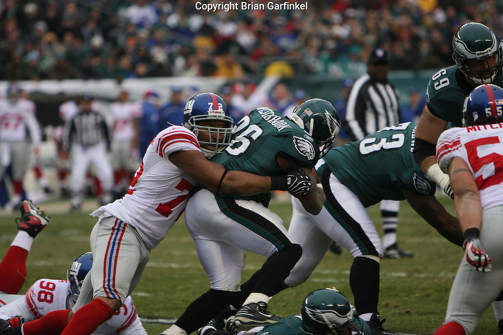 PHILADELPHIA - DECEMBER 9: Brian Westbrook #36 of the Philadelphia Eagles is taken down by #72 Osi Umenyiora of the New York Giants during the game on December 9, 2007 at Lincoln Financial Field in Philadelphia, Pennsylvania. The Giants won 16-13.