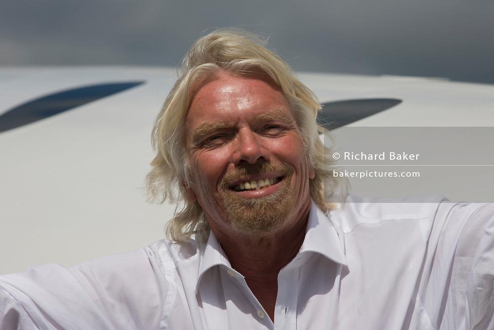 Alongside his SpaceShipTwo vehicle, Richard Branson after Virgin Galactic space tourism presentation at Farnborough