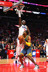November 13, 2018 - Los Angeles, CA, U.S. - LOS ANGELES, CA - NOVEMBER 12: Los Angeles Clippers Center Montrezl Harrell (5) defends Golden State Warriors Center Kevon Looney (5) as he tries to tie the score in the final minute during a NBA game between the Golden State Warriors and the Los Angeles Clippers on November 12, 2018 at STAPLES Center in Los Angeles, CA. (Photo by Brian Rothmuller/Icon Sportswire) (Credit Image: © Brian Rothmuller/Icon SMI via ZUMA Press)