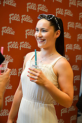 Actress CHRISTINA CHONG at a Hello! magazine and Folli Follie shopping evening at Folli Follie, 493 Oxford Street, London on 25th August 2016.
