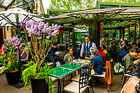 """The outdoor terrrace of La Closerie des Lilas (with pots of its namesake Lilacs), a cafe/brasserie/restauraunt on Boulevard Montparnasse, Paris, France. In the 1920's it was a haunt of writers such as Ernest Hemingway, Gertrude Stein and John Dos Passos. Hemingway mentioned the cafe in his book """"A Moveable Feast."""""""