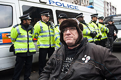 © licensed to London News Pictures. London, UK. 28/01/12. Wheelchair-bound proestor in front of police line. Disability cuts protestors chain themsevles to street furniture at Oxford Circus, shutting down traffic on Regent Street. Photo credit: Jules Mattsson/LNP