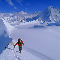 ANTARCTICA. Alex Lowe (MR) climbs Mount Bearskin (2850m) in the Ellsworth Mountains.  Mount Tyree (4852m), the continent's 2nd highest mountain is in background on right and Mount Vinson (4897m), the highest massif, is in left background.