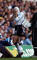 Photo. Javier Garcia<br />18/04/2003 Spurs v Man City, FA Barclaycard Premiership, White Hart Lane<br />Gus Poyet cannot show his face after the performance of his team
