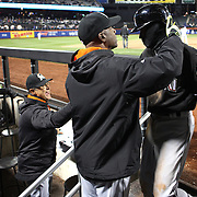 NEW YORK, NEW YORK - APRIL 12: Batting coach Barry Bonds, Miami Marlins, congratulates Dee Gordon on scoring the winning run as Manager Don Mattingly, (left), joins in the praise during the Miami Marlins Vs New York Mets MLB regular season ball game at Citi Field on April 12, 2016 in New York City. (Photo by Tim Clayton/Corbis via Getty Images)