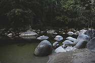 The Mossman River flows through the Mossman Gorge, not far from the town of Port Douglas, Queensland. The Mossman Gorge is a 56,000 hectare area within Australia's Daintree National Park. (August 18, 2017)