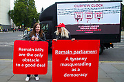 An advertising van with a reference to the situation in Kashmir passes by two Pro leave protesters outside the Houses of Parliament on 9th September 2019 in London, United Kingdom. Prime Minister Boris Johnson is tabling another motion to seek a general election.