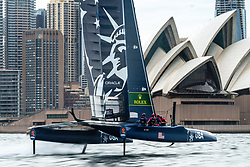 Rome Kirby, helm, flies the U.S. SailGP Team F50 towards the Sydney Opera House during a training sail prior to Sydney SailGP, Event 1 Season 2 in Sydney Harbour, Sydney, Australia. 23 February 2020. Photo: Drew Malcolm for SailGP. Handout image supplied by SailGP