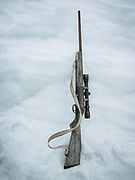 Rifle. Going seal hunting on a kayak with hunter Magnus Eraksen. Life in and around the small Inuit settlement of Isortoq (population of 64), in East Greenland.