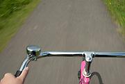 Riding the pink bike along the bike lanes at Kinderdijk.
