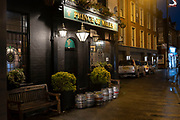 Barrels blocking the entrance to the Prince of Wales pub in Moseley due to being closed during the coronavirus restrictions on 10th December 2020 in Birmingham, United Kingdom.