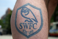 a Tattoo of Sheffield Wednesday crest on a Sheffield Wednesday fan's leg is seen outside Wembley Stadium before k/o. Skybet football league Championship play off final match, Hull city v Sheffield Wednesday at Wembley Stadium in London on Saturday 28th May 2016.<br /> pic by John Patrick Fletcher, Andrew Orchard sports photography.