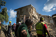 A local inhabitant waiting for the Civil Protection to take out the body from a house in Casale. A 6,4 earthquake has hit central Italy during the night between the 23 and 24 August killing more than 100. The town of Amatrice is been heavily damaged.