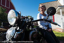 Sharon Jacobs with her 1936 Harley-Davidson VLH at the Old Town Museum in Burlington, Colorado for the hosted dinner stop during Stage 8 of the Motorcycle Cannonball Cross-Country Endurance Run, which on this day ran from Junction City, KS to Burlington, CO., USA. Saturday, September 13, 2014.  Photography ©2014 Michael Lichter.