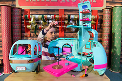"© Licensed to London News Pictures. 13/11/2019. LONDON, UK. Gwen (aged 8) plays with L.O.L. Surprise! 2-in-1 Glamper by MGA Entertainment at the preview of ""DreamToys"", the official toys and games Christmas Preview, held at St Mary's Church in Marylebone.  Recognised as the countdown to Christmas, the Toy Retailer's Association, an independent panel of leading UK toy retailers, have selected the definitive and most authoritative list of which toys will be the hottest property this Christmas.  Photo credit: Stephen Chung/LNP"