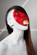 """Models Painted As Flags Eating Stereotypical Food From That Country in Jonathan Icher's 'Fat Flag' Photo Series<br /><br /><br />In his series """"Fat Flag"""", French photographer Jonathan Icher, with the help of makeup artist Anastasia Parquet, had each model decorated as their country's flag while eating food stereotyped to their nation,<br /><br />Jonathan said: """"At first, I wanted to make a fashion shoot with food. It was a challenge; I wanted to shoot the models with food in their mouth, but I wanted it to be glamour. Glamour and a little strange, but not disgusting. But i wanted the food to be graphic and colourful too. That's why for example, I chose eggs for the UK, and not beans...There is humour in this series - it's a kind of """"extreme patriotism"""".""""<br />©Jonathan Icher/Exclusivepix"""