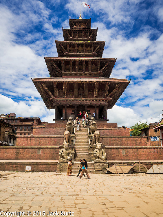 02 AUGUST 2015 - BHAKTAPUR, NEPAL:   The Nyatapola Temple is the tallest temple in Bhaktapur and one of the tallest historic structures in Nepal. It survived both the 2015 and 1934 earthquakes with no damage. Bhaktapur was badly damaged in the earthquake the hit Nepal in April 2015. The Nepal Earthquake on April 25, 2015, (also known as the Gorkha earthquake) killed more than 9,000 people and injured more than 23,000. It had a magnitude of 7.8. The epicenter was east of the district of Lamjung, and its hypocenter was at a depth of approximately 15km (9.3mi). It was the worst natural disaster to strike Nepal since the 1934 Nepal–Bihar earthquake. The earthquake triggered an avalanche on Mount Everest, killing at least 19. The earthquake also set off an avalanche in the Langtang valley, where 250 people were reported missing. Hundreds of thousands of people were made homeless with entire villages flattened across many districts of the country. Centuries-old buildings were destroyed at UNESCO World Heritage sites in the Kathmandu Valley, including some at the Kathmandu Durbar Square, the Patan Durbar Squar, the Bhaktapur Durbar Square, the Changu Narayan Temple and the Swayambhunath Stupa. Geophysicists and other experts had warned for decades that Nepal was vulnerable to a deadly earthquake, particularly because of its geology, urbanization, and architecture.      PHOTO BY JACK KURTZ