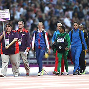 The  Women's 4 x 400 relay teams are led onto the track at the Olympic Stadium, Olympic Park, during the London 2012 Olympic games. London, UK. 11th August 2012. Photo Tim Clayton