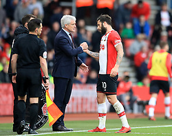 Southampton's Charlie Austin (centre) is greet by manager Mark Hughes after being substituted during the Premier League match at St Mary's, Southampton.