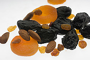 Dried fruit - apricots, almonds and prunes on white background