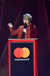 EDITORIAL USE ONLY.<br /><br />Ed Sheeran on stage at the Brit Awards at the O2 Arena, London.
