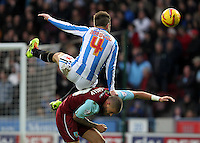 Burnley's Michael Kightly battles with  Huddersfield Town's Oliver Norwood<br /><br />Photo by Mick Walker/CameraSport<br /><br />Football - The Football League Sky Bet Championship - Huddersfield Town v Burnley - Saturday 30th November 2013 - The John Smith's Stadium - Huddersfield<br /><br />© CameraSport - 43 Linden Ave. Countesthorpe. Leicester. England. LE8 5PG - Tel: +44 (0) 116 277 4147 - admin@camerasport.com - www.camerasport.com