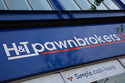 Sign for the loans brand H&T Pawnbrokers in Birmingham, United Kingdom.