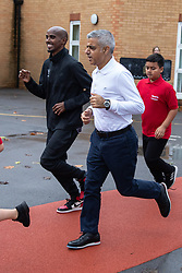 © Licensed to London News Pictures. 15/10/2018. London, UK. Mayor of London Sadiq Khan (right) and British athlete Sir Mohamed Farah (left) launch a campaign at Cubitt Town Junior School to encourage London schools to take part in the Daily Mile initiative. The Daily Mile gets school children exercising outside for 15 minutes a day, to improve their physical, social, emotional and mental health and wellbeing. Photo credit : Tom Nicholson/LNP
