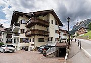 Our favorite lodging in the Dolomites was Garni Murfrëid, in Selva di Val Gardena in Trentino-Alto Adige/Südtirol (South Tyrol), Italy, Europe. The beautiful ski resort of Selva di Val Gardena (German: Wolkenstein in Gröden; Ladin: Sëlva Gherdëine) makes a great hiking base in the Trentino-Alto Adige/Südtirol (South Tyrol) region of Italy, in the Dolomites, part of the Southern Limestone Alps, Europe. For our favorite hike in the Dolomiti, start with the first morning bus to Ortisei, take the Seceda lift, admire the great views from the cross, then walk 12 miles (2000 feet up, 5000 feet down) via the steep pass Furcela Forces De Sieles (Forcella Forces de Sielles) to beautiful Vallunga (trail #2 to 16), finishing where you started in Selva. The hike traverses the Puez-Geisler Group from verdant pastures to alpine pleasures, all preserved in a vast Nature Park: Parco Naturale Puez-Odle (German: Naturpark Puez-Geisler; Ladin: Parch Natural Pöz-Odles), including the deeply glaciated U-shaped valley of Vallunga (Langental). Apropos the idyllic grazing of sheep and cows en route, Saint Sylvester's Chapel (San Silvestro) in Vallunga is dedicated to the patron saint of cattle and contains 300-year-old frescoes depicting the life of Jesus. UNESCO honored the Dolomites as a natural World Heritage Site in 2009. This panorama was stitched from 4 overlapping photos.