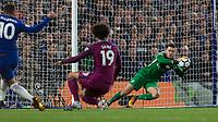 Football - 2017 / 2018 Premier League - Chelsea vs Manchester City<br /> <br /> Ederson Moraes (Manchester City) saves from Eden Hazard (Chelsea FC)  at Stamford Bridge <br /> <br /> COLORSPORT/DANIEL BEARHAM